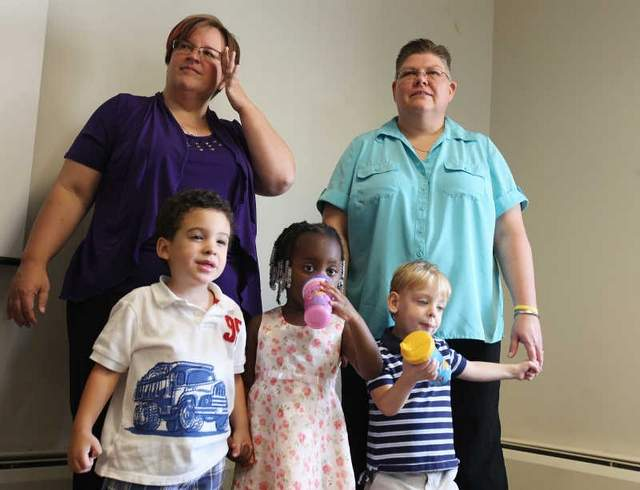 Lesbian moms April DeBoer and Jayne Rowse, from suburban Detroit, announced their challenge to Michigan's constitutional ban on same-sex marriage with their three children at a news conference.