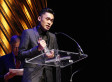"Nicholas Wong accepts the Lambda Literary Award for his collection of gay poetry, ""Crevasse,"" published by Kaya Press."