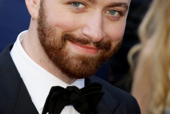 A photo of Sam Smith dressed in a tuxedo.