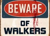 "A bloody sign that reads, ""Beware of walkers."""