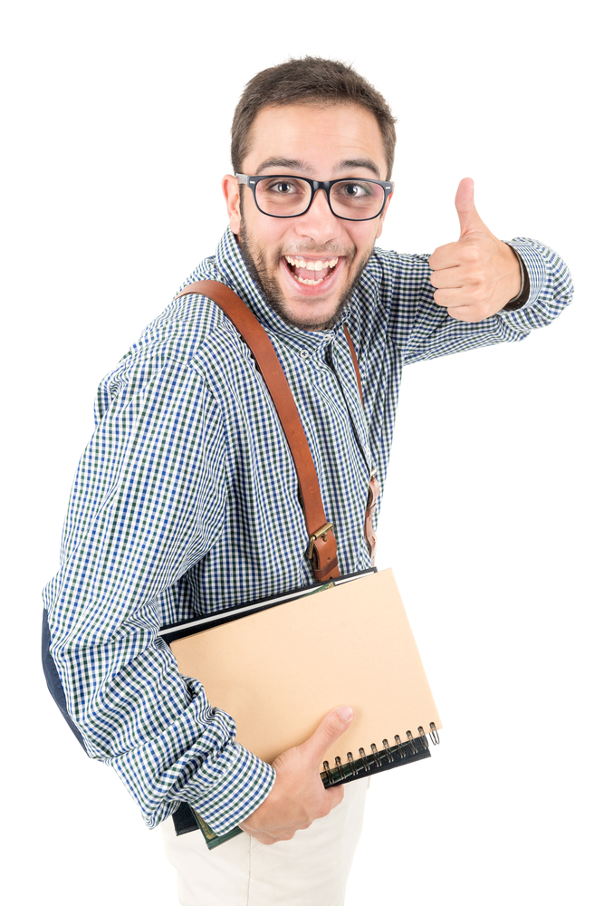 A white man wearing glasses and suspenders gives a thumbs up to the camera.