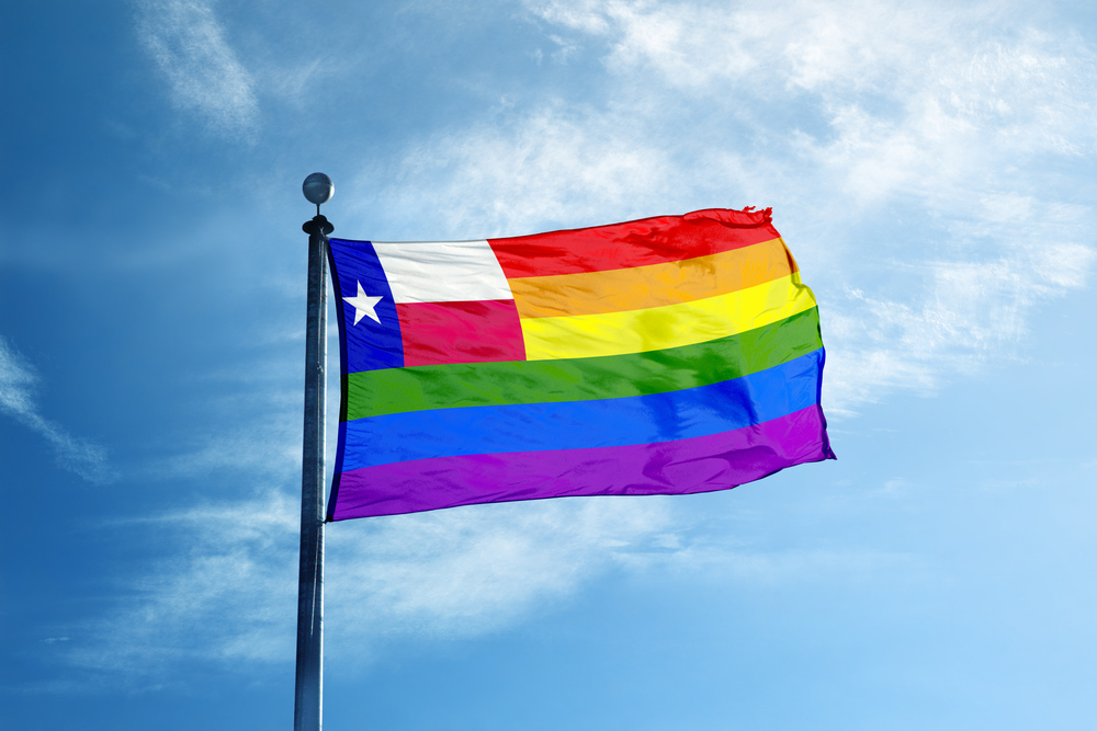 A rainbow flag with the Texas flag inside of it.