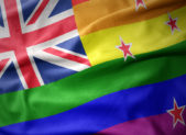 New Zealand's flag, pictured in rainbow colors.