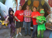 """A photo of Disneyland tourists posing in red """"Gay Days"""" shirts."""