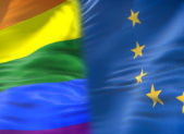 A rainbow flag placed next to the E.U. flag.