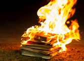 A stack of book on fire.