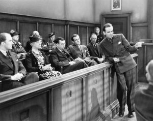 A black-and-white photo of a Caucasian jury.