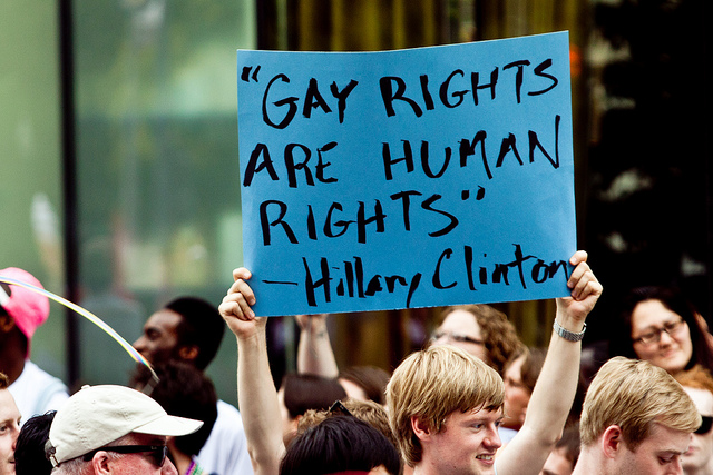 Marchers in the 2011 Washington DC Capitol Pride Parade show their support for Hillary Clinton.
