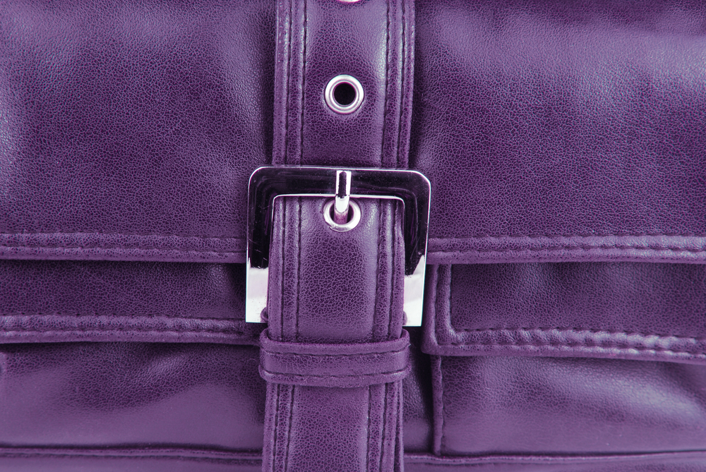 A close-up photo of a purple purse.