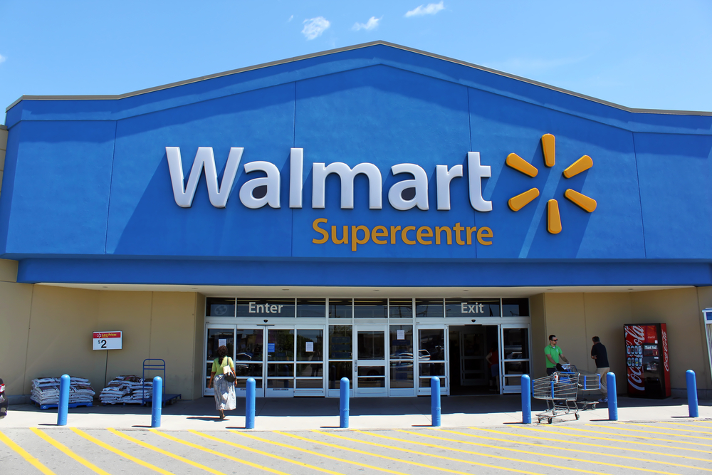 A photo of a Walmart building shown from the outside.