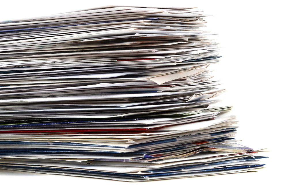 A photo of a stack of mail.
