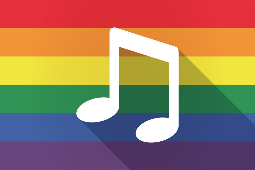 A rainbow flag with a music note on the front of it.