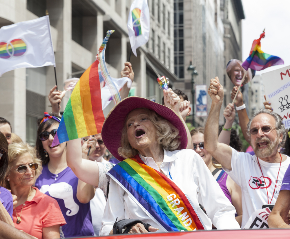 "Edith ""Edie"" Windsor at the 43rd Annual Pride Parade in New York. She is wearing a rainbow sash."