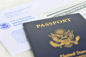 "A photo of a passport next to an official document titled ""U.S. Citizenship and immigration services."""