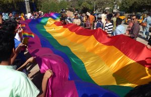 February 19, 2017: LGBT activists hold a long rainbow colored flag demanding equality during Queer Swabhimana Yatra in Hyderabad, India.