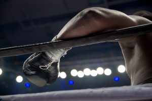 A close-up photo of a boxer in a ring.