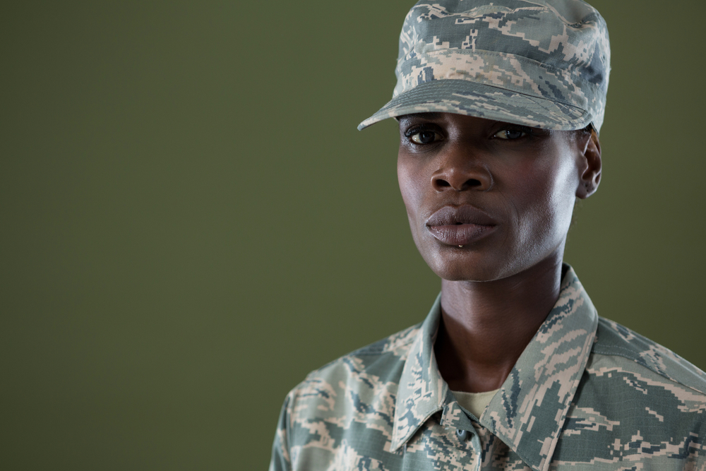 An androgynous soldier in uniform.