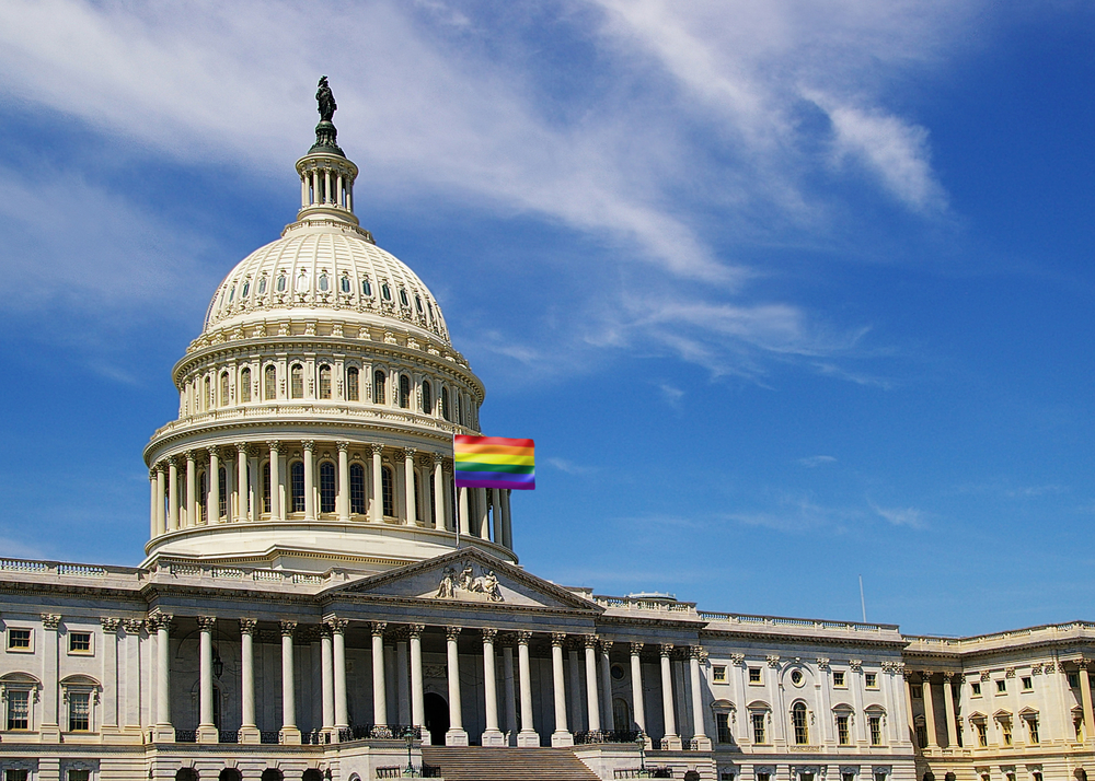 A rainbow flag placed in front of the U.S. Capitol building.