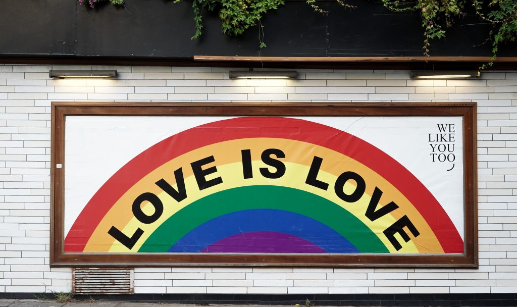 "a painting with the words ""love is love"""